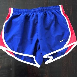 Nike tempo dry-fit blue and red shorts.